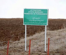 south_ossetia_border_sign_warning_Crop