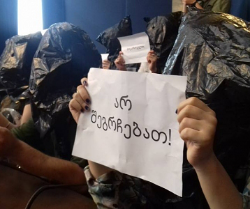 Protesters put bags over their heads as parliament silent on Mukhtarli case